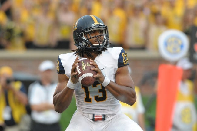 Aug 31, 2013; Columbia, MO, USA; Murray State Racers quarterback Maikhail Miller (13) passes the ball during the first half of the game against the Missouri Tigers at Faurot Field. Missouri won 58-14. Mandatory Credit: Denny Medley-USA TODAY Sports