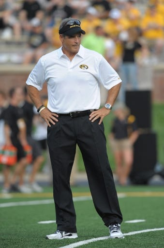 Aug 31, 2013; Columbia, MO, USA; Missouri Tigers head coach Gary Pinkel watches the team warmup before the game against the Murray State Racers at Faurot Field. Missouri won 58-14. Mandatory Credit: Denny Medley-USA TODAY Sports
