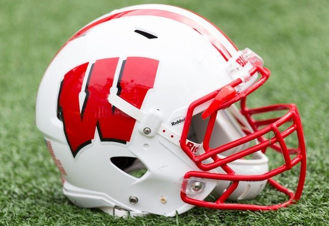 Aug 31, 2013; Madison, WI, USA; A Wisconsin Badgers helmet sits on the field during warmups prior to the game against the Massachusetts Minutemen at Camp Randall Stadium.  Wisconsin won 45-0.  Mandatory Credit: Jeff Hanisch-USA TODAY Sports