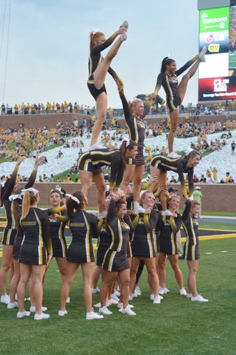 Aug 31, 2013; Columbia, MO, USA; Missouri Tigers cheerleaders perform on field during the game against the Murray State Racers at Faurot Field. Missouri won 58-14. Mandatory Credit: Denny Medley-USA TODAY Sports