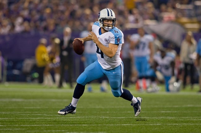 Aug 29, 2013; Minneapolis, MN, USA; Tennessee Titans quarterback Ryan Fitzpatrick (4) passes for a touchdown against the Minnesota Vikings in the second quarter at Mall of America Field at H.H.H. Metrodome. Mandatory Credit: Bruce Kluckhohn-USA TODAY Sports