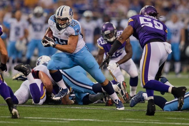Aug 29, 2013; Minneapolis, MN, USA; Tennessee Titans running back Jackie Battle (22) rushes for 9 yards on fourth down against the Minnesota Vikings for a first down in the first quarter at Mall of America Field at H.H.H. Metrodome. Mandatory Credit: Bruce Kluckhohn-USA TODAY Sports