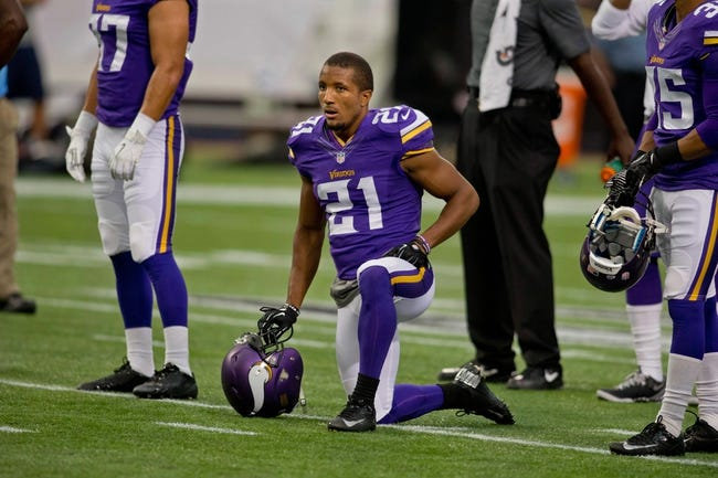 Aug 29, 2013; Minneapolis, MN, USA; Minnesota Vikings cornerback Josh Robinson (21) rests between drills before the game with the Tennessee Titans at Mall of America Field at H.H.H. Metrodome. Vikings win 24-23. Mandatory Credit: Bruce Kluckhohn-USA TODAY Sports