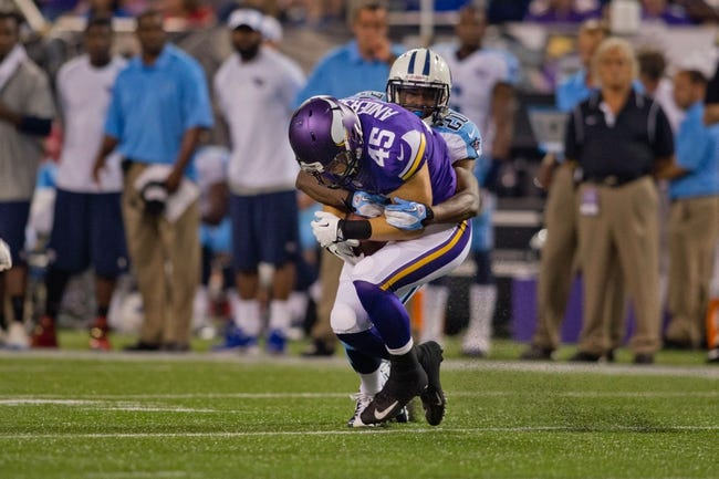 Aug 29, 2013; Minneapolis, MN, USA; Tennessee Titans cornerback Alterraun Verner (20) tackles Minnesota Vikings tight end Colin Anderson (45) in the second quarter at Mall of America Field at H.H.H. Metrodome. Vikings win 24-23. Mandatory Credit: Bruce Kluckhohn-USA TODAY Sports