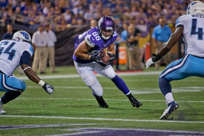 Aug 29, 2013; Minneapolis, MN, USA; Minnesota Vikings tight end Chase Ford (86) catches the ball before he fumbles it to the Tennessee Titans just before the goal line at Mall of America Field at H.H.H. Metrodome. The Titans recover the ball. Vikings win 24-23. Mandatory Credit: Bruce Kluckhohn-USA TODAY Sports