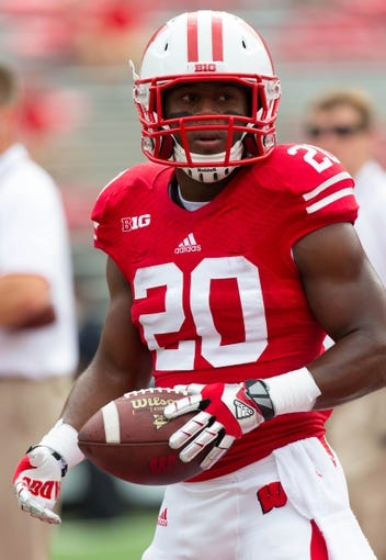 Aug 31, 2013; Madison, WI, USA; Wisconsin Badgers running back James White (20) during warmups prior to the game against the Massachusetts Minutemen at Camp Randall Stadium.  Wisconsin won 45-0.  Mandatory Credit: Jeff Hanisch-USA TODAY Sports