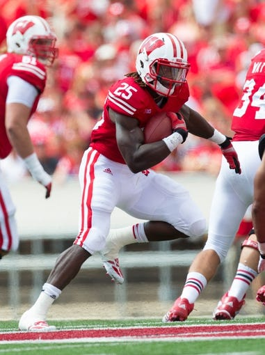Aug 31, 2013; Madison, WI, USA; Wisconsin Badgers running back Melvin Gordon (25) during the game against the Massachusetts Minutemen at Camp Randall Stadium.  Wisconsin won 45-0.  Mandatory Credit: Jeff Hanisch-USA TODAY Sports