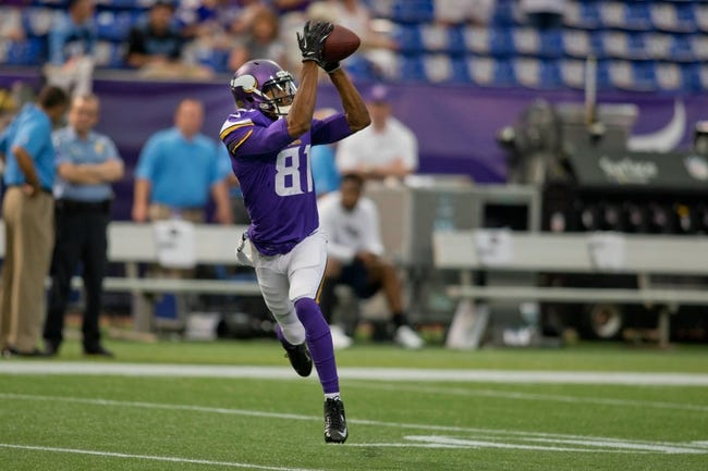 Aug 29, 2013; Minneapolis, MN, USA; Minnesota Vikings wide receiver Stephen Burton (11) catches a pass in drills before the game with the Tennessee Titans at Mall of America Field at H.H.H. Metrodome. Vikings win 24-23. Mandatory Credit: Bruce Kluckhohn-USA TODAY Sports