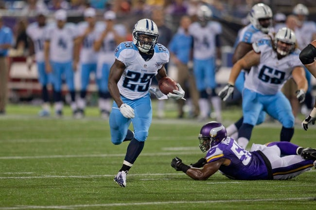 Aug 29, 2013; Minneapolis, MN, USA; Tennessee Titans running back Darius Reynaud (25) rushes against the Minnesota Vikings in the third quarter at Mall of America Field at H.H.H. Metrodome. Vikings win 24-23. Mandatory Credit: Bruce Kluckhohn-USA TODAY Sports