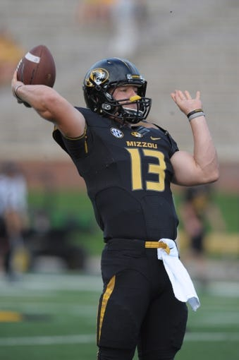 Aug 31, 2013; Columbia, MO, USA; Missouri Tigers quarterback Corbin Berkstresser (13) warms up before the game against the Murray State Racers at Faurot Field. Missouri won 58-14. Mandatory Credit: Denny Medley-USA TODAY Sports