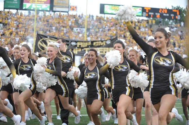 Aug 31, 2013; Columbia, MO, USA; Missouri Tigers cheerleaders perform on field before the game against the Murray State Racers at Faurot Field. Missouri won 58-14. Mandatory Credit: Denny Medley-USA TODAY Sports