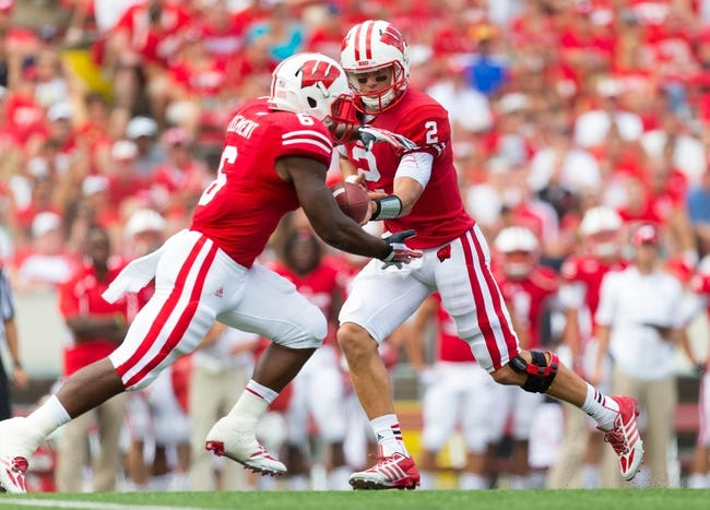Aug 31, 2013; Madison, WI, USA; Wisconsin Badgers quarterback Joel Stave (2) hands the football to running back Corey Clement (6) during the game against the Massachusetts Minutemen at Camp Randall Stadium.  Wisconsin won 45-0.  Mandatory Credit: Jeff Hanisch-USA TODAY Sports
