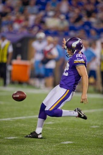 Aug 29, 2013; Minneapolis, MN, USA; Minnesota Vikings punter Jeff Locke (12) punts to the Tennessee Titans at Mall of America Field at H.H.H. Metrodome. Vikings win 24-23. Mandatory Credit: Bruce Kluckhohn-USA TODAY Sports