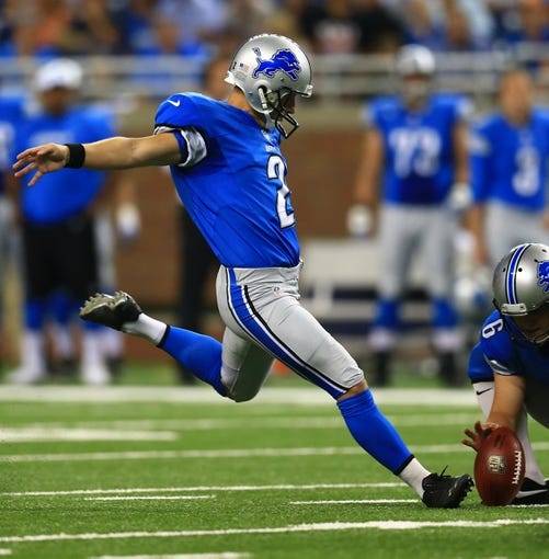 Aug 9, 2013; Detroit, MI, USA; Detroit Lions kicker David Akers (2) kicks a field goal in the first quarter of a preseason game against the New York Jets at Ford Field. Mandatory Credit: Andrew Weber-USA TODAY Sports