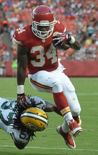 Aug 29, 2013; Kansas City, MO, USA; Kansas City Chiefs running back Knile Davis (34) during the first half of the game against the Green Bay Packers at Arrowhead Stadium. The Chiefs won 30-8. Mandatory Credit: Denny Medley-USA TODAY Sports