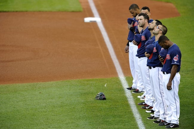 Sep 4, 2013; Cleveland, OH, USA; The Cleveland Indians stand during the national anthem before a game against the Baltimore Orioles at Progressive Field. Mandatory Credit: David Richard-USA TODAY Sports