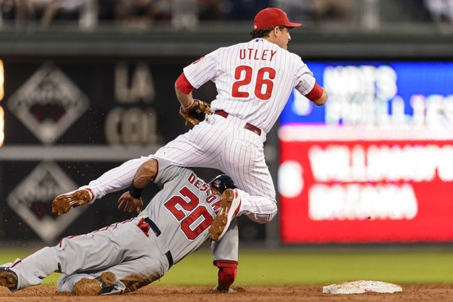 Sep 4, 2013; Philadelphia, PA, USA; Washington Nationals shortstop Ian Desmond (20) upends Philadelphia Phillies second baseman Chase Utley (26) after being forced out at second base on the front end of a double play during the first inning at Citizens Bank Park. Mandatory Credit: Howard Smith-USA TODAY Sports