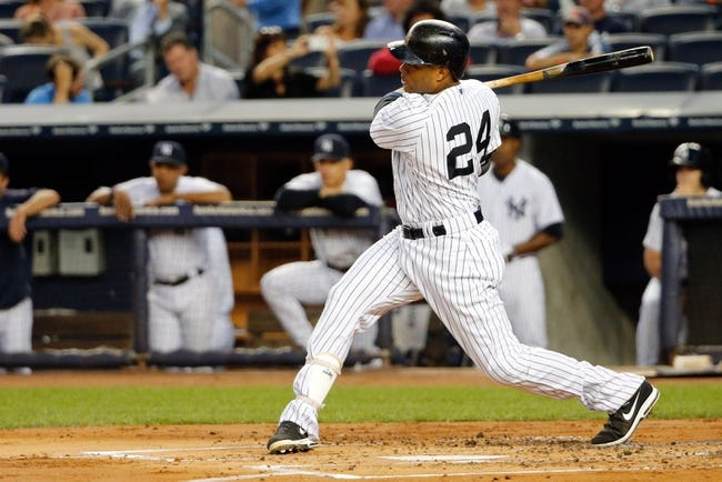Sep 4, 2013; Bronx, NY, USA;  New York Yankees second baseman Robinson Cano (24) hits a solo home run to right during the first inning against the Chicago White Sox at Yankee Stadium. Mandatory Credit: Anthony Gruppuso-USA TODAY Sports