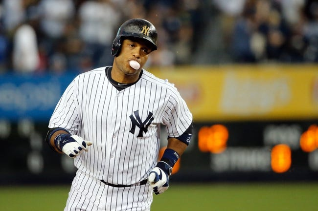 Sep 4, 2013; Bronx, NY, USA;  New York Yankees second baseman Robinson Cano (24) rounds the bases on his home run during the first inning against the Chicago White Sox at Yankee Stadium. Mandatory Credit: Anthony Gruppuso-USA TODAY Sports