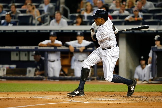 Sep 4, 2013; Bronx, NY, USA;  New York Yankees right fielder Curtis Granderson (14) doubles to deep right advancing a man during the first inning against the Chicago White Sox at Yankee Stadium. Mandatory Credit: Anthony Gruppuso-USA TODAY Sports