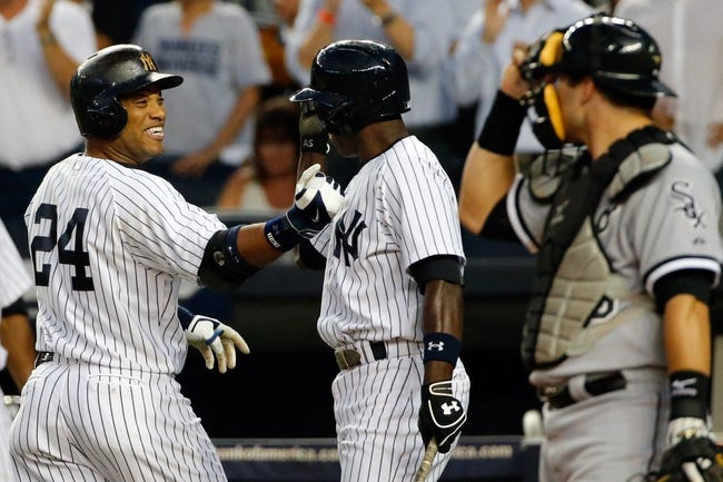 Sep 4, 2013; Bronx, NY, USA;  New York Yankees second baseman Robinson Cano (24) celebrates his home run with left fielder Alfonso Soriano (12) during the first inning against the Chicago White Sox at Yankee Stadium. Mandatory Credit: Anthony Gruppuso-USA TODAY Sports