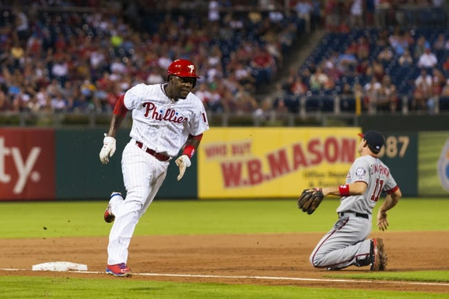 Sep 4, 2013; Philadelphia, PA, USA; Philadelphia Phillies left fielder fielder John Mayberry (15) rounds third on his way to scoring during the second inning against the Washington Nationals at Citizens Bank Park. Mandatory Credit: Howard Smith-USA TODAY Sports