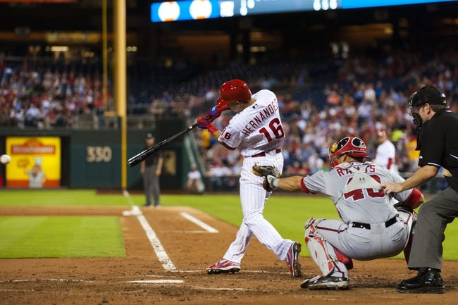 Sep 4, 2013; Philadelphia, PA, USA; Philadelphia Phillies center fielder Cesar Hernandez (16) hits a two RBI double during the second inning against the Washington Nationals at Citizens Bank Park. Mandatory Credit: Howard Smith-USA TODAY Sports