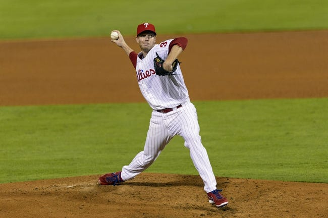 Sep 4, 2013; Philadelphia, PA, USA; Philadelphia Phillies pitcher Roy Halladay (34) delivers to the plate during the fourth inning against the Washington Nationals at Citizens Bank Park. Mandatory Credit: Howard Smith-USA TODAY Sports