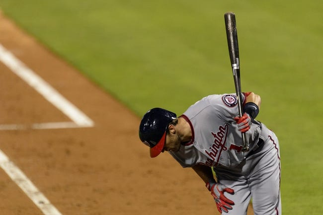 Sep 4, 2013; Philadelphia, PA, USA; Washington Nationals second baseman Steve Lombardozzi (1) reacts to being hit by a pitch during the fourth inning against the Philadelphia Phillies at Citizens Bank Park. Mandatory Credit: Howard Smith-USA TODAY Sports