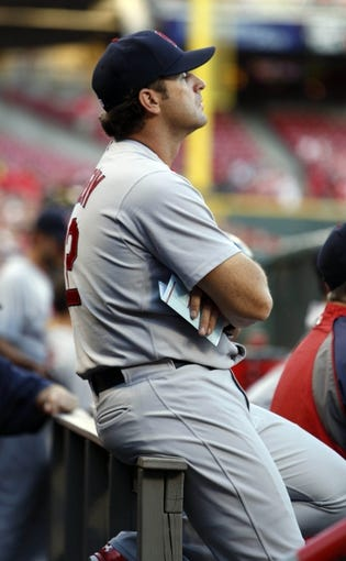 Sep 4, 2013; Cincinnati, OH, USA; St. Louis Cardinals manager watches from the dugout at the beginning of a game against the Cincinnati Reds at Great American Ball Park. Mandatory Credit: David Kohl-USA TODAY Sports