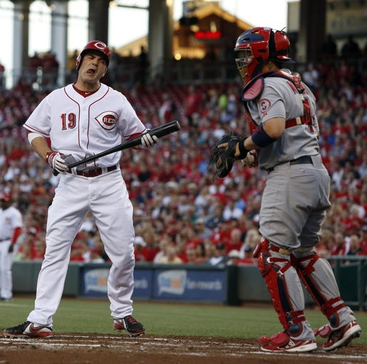 Sep 4, 2013; Cincinnati, OH, USA; Cincinnati Reds first baseman Joey Votto (19) reacts in front of St. Louis Cardinals catcher Yadier Molina (4) after striking out in the in the first inning at Great American Ball Park. Mandatory Credit: David Kohl-USA TODAY Sports
