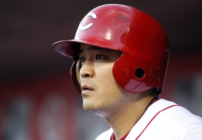 Sep 4, 2013; Cincinnati, OH, USA; Cincinnati Reds center fielder Shin-Soo Choo watches from the dugout during a game against the St. Louis Cardinals at Great American Ball Park. Mandatory Credit: David Kohl-USA TODAY Sports