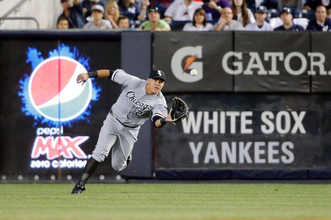 Sep 4, 2013; Bronx, NY, USA;  Chicago White Sox right fielder Avisail Garcia (26) leans for the catch during the third inning against the New York Yankees at Yankee Stadium. Mandatory Credit: Anthony Gruppuso-USA TODAY Sports