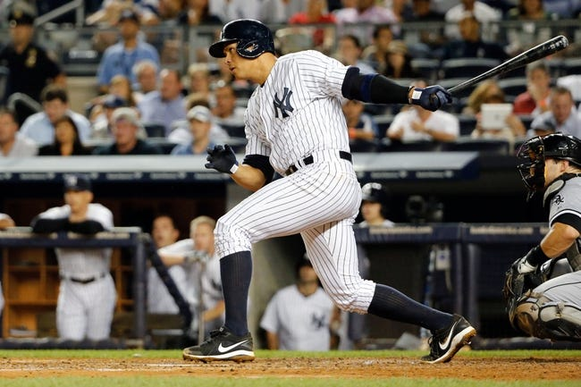 Sep 4, 2013; Bronx, NY, USA;  New York Yankees third baseman Alex Rodriguez (13) singles to center during the fourth inning against the Chicago White Sox at Yankee Stadium. Mandatory Credit: Anthony Gruppuso-USA TODAY Sports