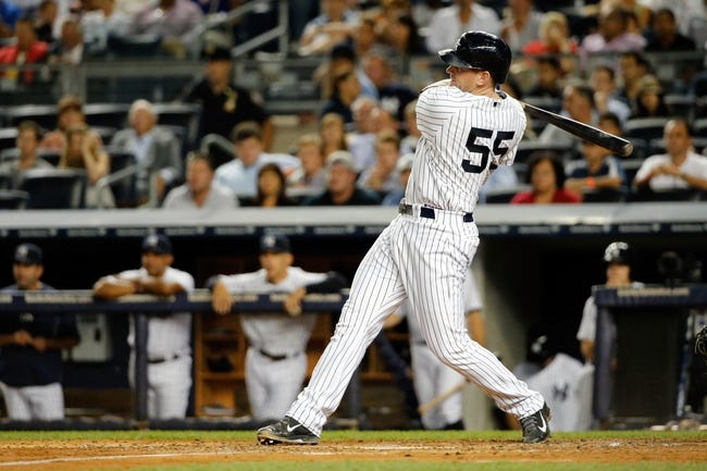 Sep 4, 2013; Bronx, NY, USA;  New York Yankees first baseman Lyle Overbay (55) doubles to deep right allowing a runner to score and a man to advance during the fourth inning against the Chicago White Sox at Yankee Stadium. Mandatory Credit: Anthony Gruppuso-USA TODAY Sports