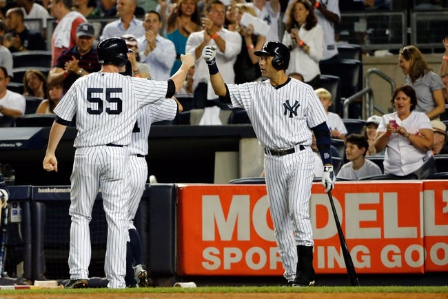 Sep 4, 2013; Bronx, NY, USA;  New York Yankees first baseman Lyle Overbay (55) celebrates scoring with shortstop Derek Jeter (2) during the fourth inning against the Chicago White Sox at Yankee Stadium. Mandatory Credit: Anthony Gruppuso-USA TODAY Sports