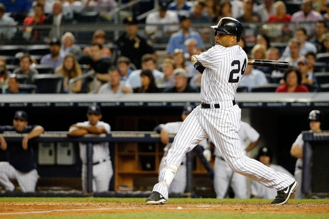 Sep 4, 2013; Bronx, NY, USA;  New York Yankees second baseman Robinson Cano (24) reaches on an infield single to third allowing a runner to score during the fourth inning against the Chicago White Sox at Yankee Stadium. Mandatory Credit: Anthony Gruppuso-USA TODAY Sports