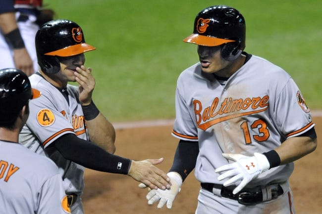 Sep 4, 2013; Cleveland, OH, USA; Baltimore Orioles third baseman Manny Machado (13) celebrates his three-run home run with second baseman Brian Roberts (1) in the fifth inning against the Cleveland Indians at Progressive Field. Mandatory Credit: David Richard-USA TODAY Sports