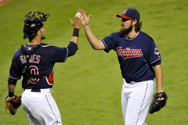 Sep 4, 2013; Cleveland, OH, USA; Cleveland Indians catcher Yan Gomes (10) and relief pitcher Chris Perez (54) celebrate a 6-4 win over the Baltimore Orioles at Progressive Field. Mandatory Credit: David Richard-USA TODAY Sports