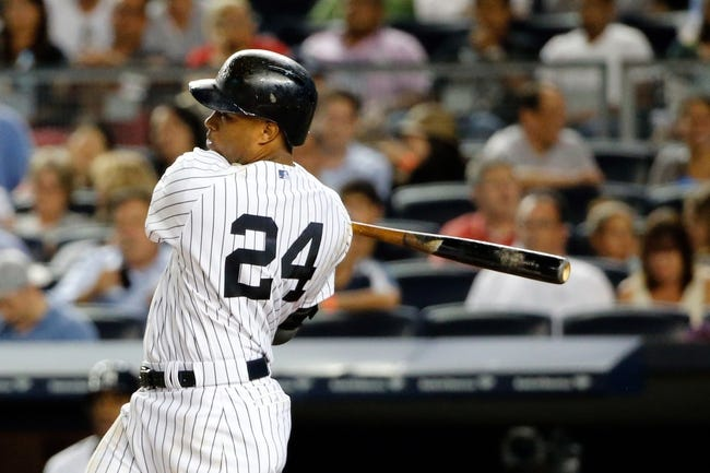 Sep 4, 2013; Bronx, NY, USA;  New York Yankees second baseman Robinson Cano (24) singles to right during the seventh inning against the Chicago White Sox at Yankee Stadium. Yankees won 6-5.  Mandatory Credit: Anthony Gruppuso-USA TODAY Sports