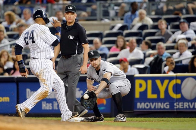 Sep 4, 2013; Bronx, NY, USA;  New York Yankees second baseman Robinson Cano (24) steps back to first as Chicago White Sox second baseman Jeff Keppinger (7) is late with the tag during the seventh inning at Yankee Stadium. Yankees won 6-5.  Mandatory Credit: Anthony Gruppuso-USA TODAY Sports