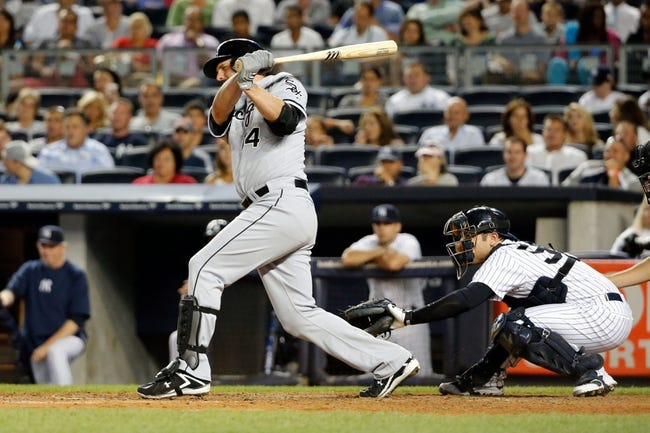 Sep 4, 2013; Bronx, NY, USA;  Chicago White Sox first baseman Paul Konerko (14) singles to left during the eighth inning against the New York Yankees at Yankee Stadium. Yankees won 6-5.  Mandatory Credit: Anthony Gruppuso-USA TODAY Sports