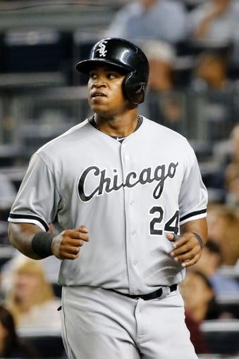 Sep 4, 2013; Bronx, NY, USA;  Chicago White Sox left fielder Dayan Viciedo (24) heads to the dugout after scoring during the eighth inning against the New York Yankees at Yankee Stadium. Yankees won 6-5.  Mandatory Credit: Anthony Gruppuso-USA TODAY Sports