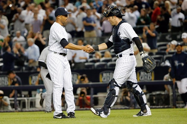 Sep 4, 2013; Bronx, NY, USA;  New York Yankees relief pitcher Mariano Rivera (42) and catcher Austin Romine (53) celebrate the win against the Chicago White Sox at Yankee Stadium. Yankees won 6-5.  Mandatory Credit: Anthony Gruppuso-USA TODAY Sports