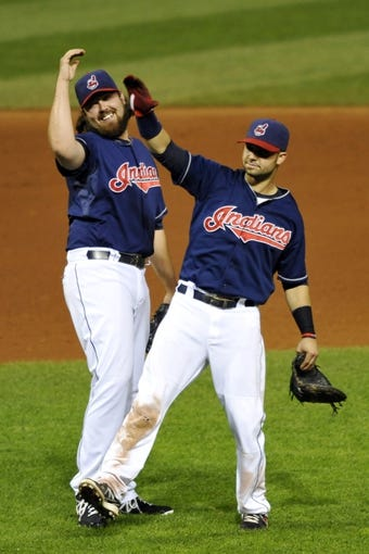 Sep 4, 2013; Cleveland, OH, USA; Cleveland Indians relief pitcher Chris Perez (left) and first baseman Nick Swisher (33) celebrate a 6-4 win over the Baltimore Orioles at Progressive Field. Mandatory Credit: David Richard-USA TODAY Sports