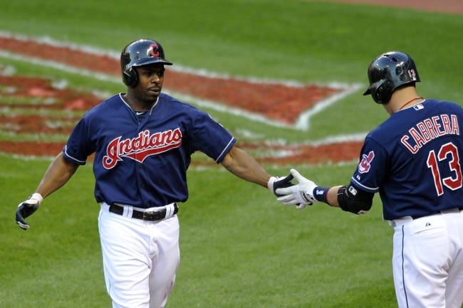 Sep 4, 2013; Cleveland, OH, USA; Cleveland Indians center fielder Michael Bourn (left) celebrates with shortstop Asdrubal Cabrera (13) after scoring in the first inning against the Baltimore Orioles at Progressive Field. Mandatory Credit: David Richard-USA TODAY Sports