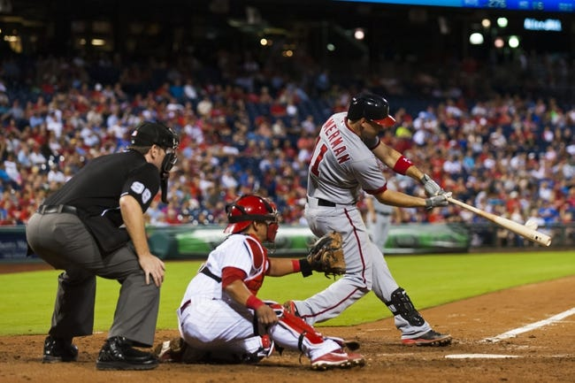 Sep 4, 2013; Philadelphia, PA, USA; Washington Nationals third baseman Ryan Zimmerman (11) hits a home run during the seventh inning against the Philadelphia Phillies at Citizens Bank Park. The Nationals defeated the Phillies 3-2. Mandatory Credit: Howard Smith-USA TODAY Sports