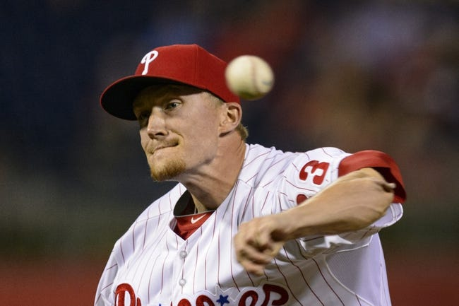 Sep 4, 2013; Philadelphia, PA, USA; Philadelphia Phillies pitcher Jake Diekman (63) delivers to the plate during the eighth inning against the Washington Nationals at Citizens Bank Park. The Nationals defeated the Phillies 3-2. Mandatory Credit: Howard Smith-USA TODAY Sports