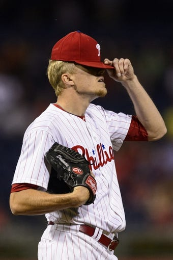 Sep 4, 2013; Philadelphia, PA, USA; Philadelphia Phillies pitcher Jake Diekman (63) adjusts his cap during the eighth inning against the Washington Nationals at Citizens Bank Park. The Nationals defeated the Phillies 3-2. Mandatory Credit: Howard Smith-USA TODAY Sports