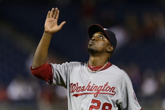 Sep 4, 2013; Philadelphia, PA, USA; Washington Nationals pitcher Rafael Soriano (29) celebrates pitching the ninth inning against the Philadelphia Phillies at Citizens Bank Park. The Nationals defeated the Phillies 3-2. Mandatory Credit: Howard Smith-USA TODAY Sports
